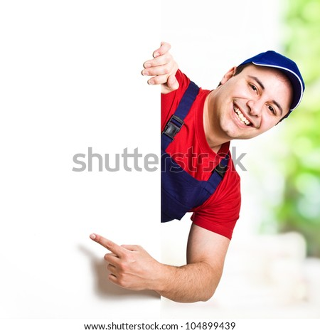Worker showing a blank sign - stock photo