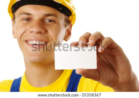 Worker showing his business card and smile, isolated over white - stock photo
