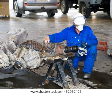 worker shows on a detail - stock photo