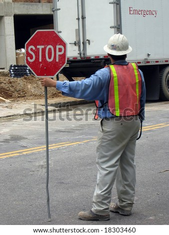 Worker Stopping Traffic for Emergency - stock photo