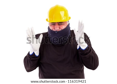 Worker suffering cold with arms up isolated on white - stock photo