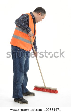 Worker sweeping with besom - stock photo
