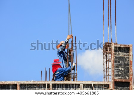 Worker team in building site - stock photo