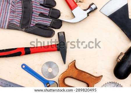 Worker tools on a wooden surface.