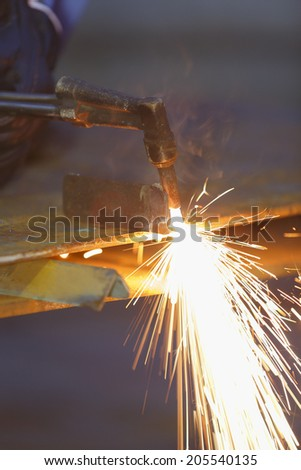 worker use acetylene torch to cutting metal - stock photo