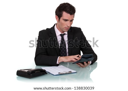 Worker using calculator - stock photo