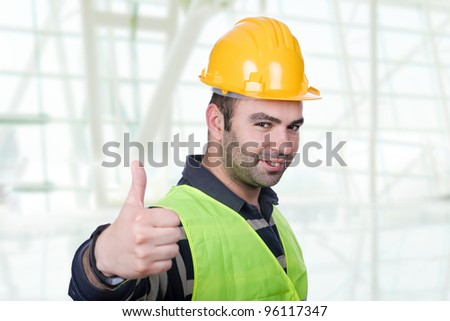 Worker wearing hard hat and going thumb up