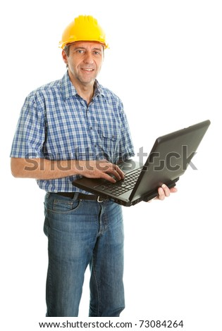 Worker wearing hard hat and using leptop - stock photo