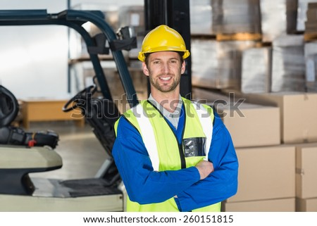 Worker wearing hard hat in warehouse in the warehouse - stock photo