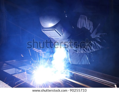Worker welding metal. Production and construction - stock photo