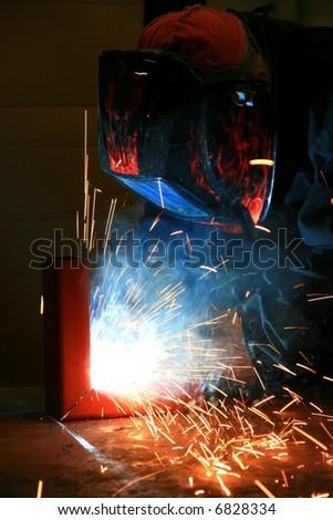 Worker welding steel - stock photo