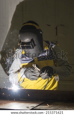 Worker welding the steel part by manual