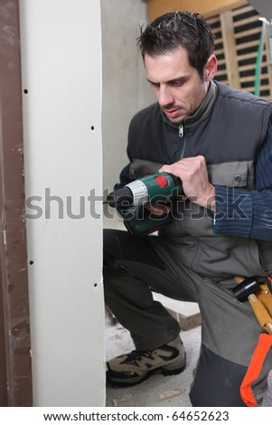 Worker with a drill - stock photo