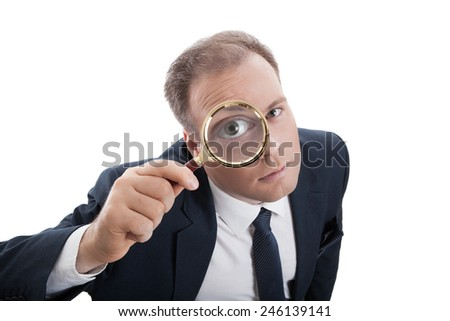 worker with a magnifying glass looking for