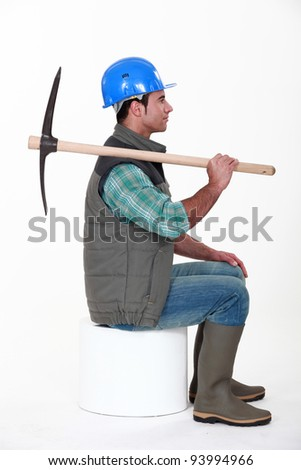 Worker with a pickaxe - stock photo