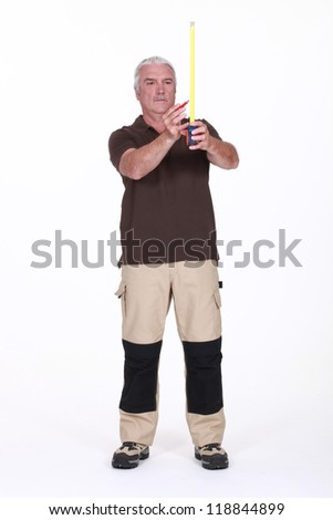 Worker with a tape measure - stock photo