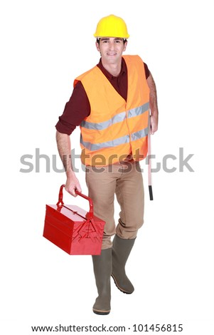 Worker with a tool box - stock photo