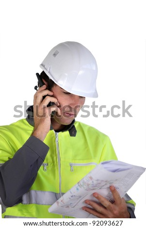 Worker with a two-way radio - stock photo
