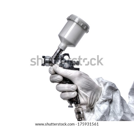 Worker with airbrush gun, isolated on white background - stock photo
