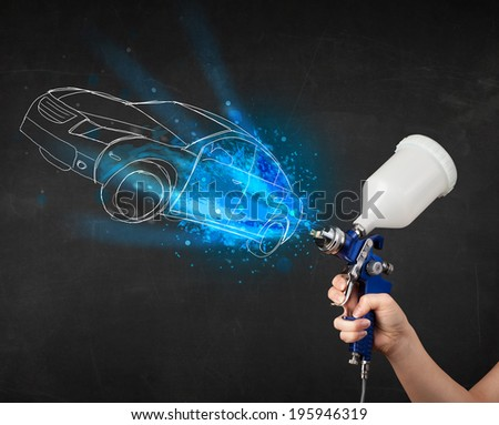 Worker with airbrush gun painting hand drawn white car lines - stock photo