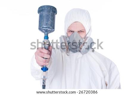 Worker with airbrush gun, selective focus on gun - stock photo