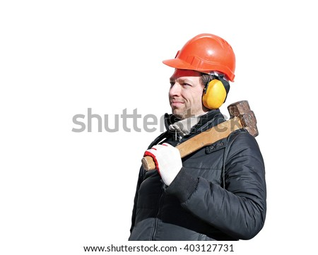 Worker with big sledge hammer on the shoulder isolated on white background