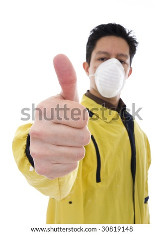 Worker with face mask giving the thumb-up sign - stock photo