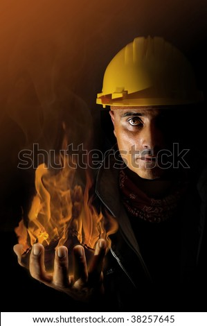 Worker with fire burning in his hand