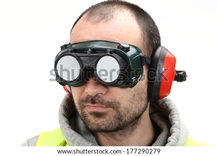worker with goggles and earphones over white