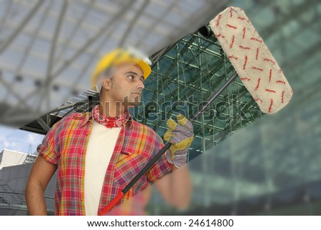 worker with hat cleaning glass - stock photo