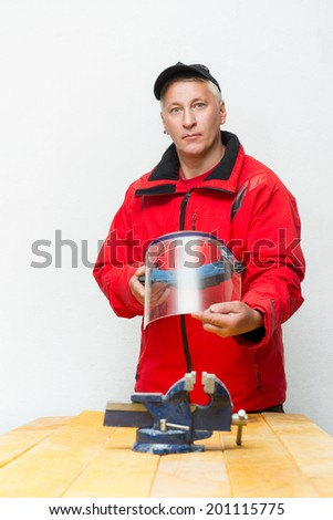Worker with helmet in the workshop - stock photo