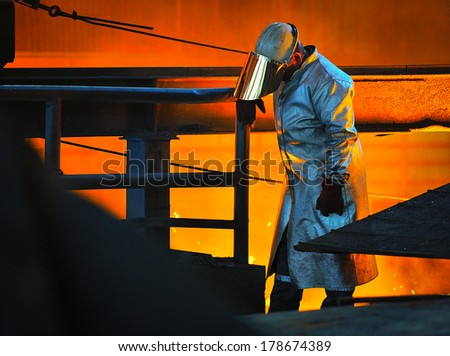 worker with hot steel - stock photo