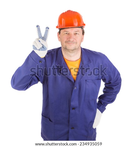 Worker with peace sign. Isolated on a white background. - stock photo