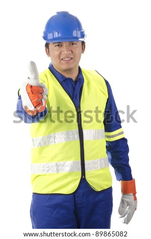 worker with personal protective equipment shows thumb up - stock photo