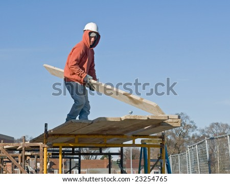 Worker with Planks for Scaffolding