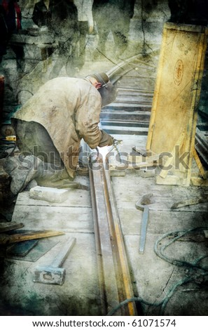worker with protective mask and gloves welding train rail and sparks spreading -  picture in retro style - stock photo