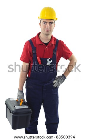 worker with safety equipment holding a toolbox isolated on white background - stock photo
