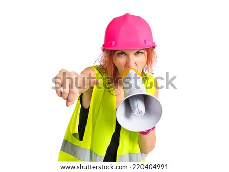 Worker woman shouting over isolated white background. - stock photo