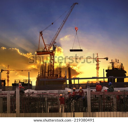 worker working in high building construction site against beautiful dusky sky use for construction business and land ,real estate ,civil development - stock photo
