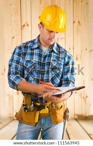 worker write on clipboard - stock photo