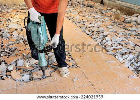 Workers are using electric drilling. - stock photo