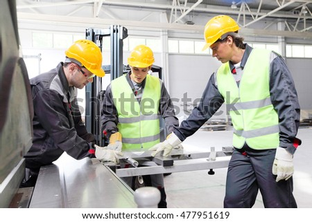 Workers at CNC machine shop with lathes