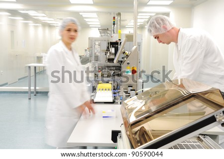 Workers at modern drug factory