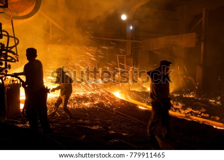 Workers at tapping of the blast furnace