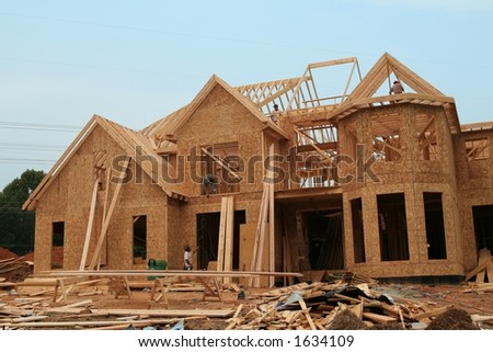workers building a house in the suburbs