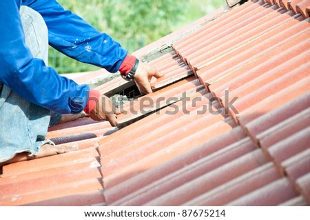workers construct for repairing roof - stock photo