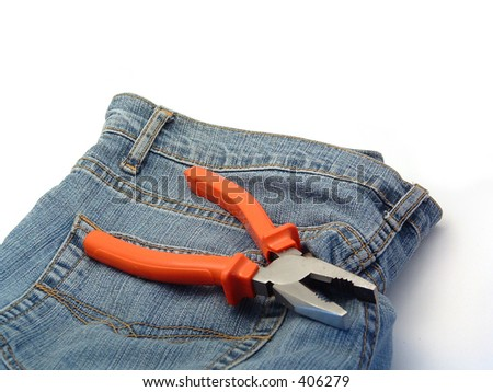 workers denim pants and pliers on it - stock photo