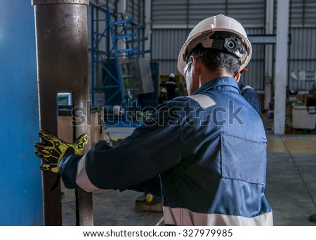 Workers drilling for oil - stock photo