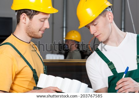 Workers during control and inventory at warehouse - stock photo