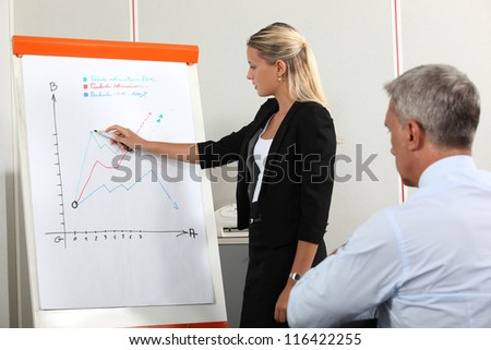 Workers examining growth performance - stock photo
